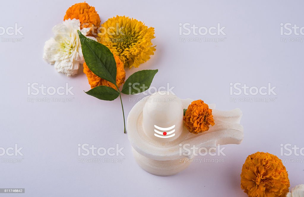 Shiva Linga made up of white marble with flowers, mahashivaratri stock photo