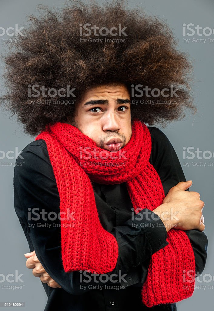 shivering funky man with big red wool shawl stock photo