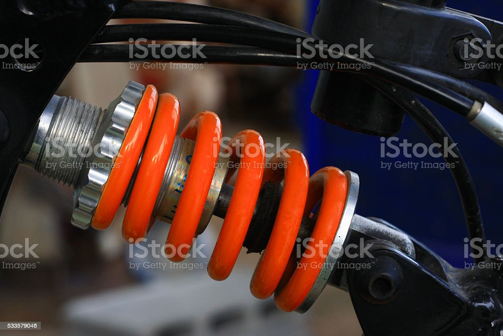 Shock absorber of the beautiful colors of the bike. stock photo