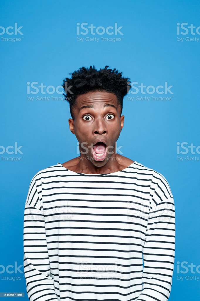 Shock, Afro american staring at camera with mouth open stock photo