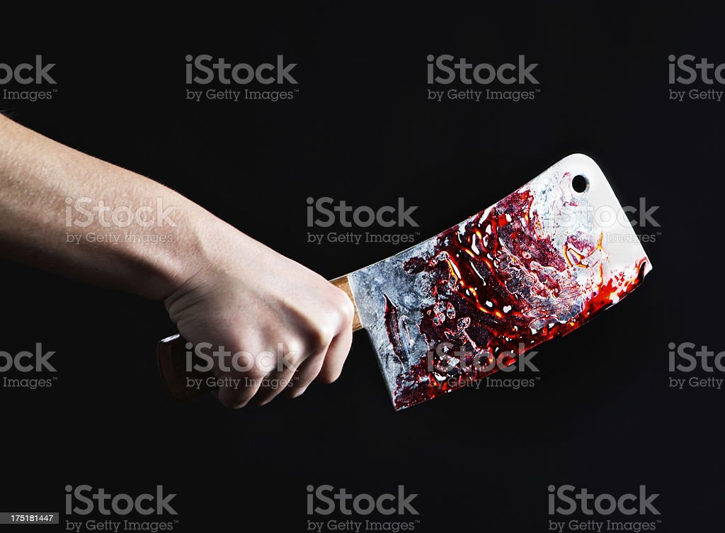 Shock, horror! Hand holding meat cleaver covered in clotted blood stock photo