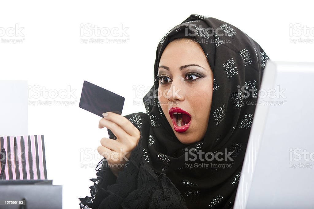 Shocked Arabic girl shopping on the internet royalty-free stock photo