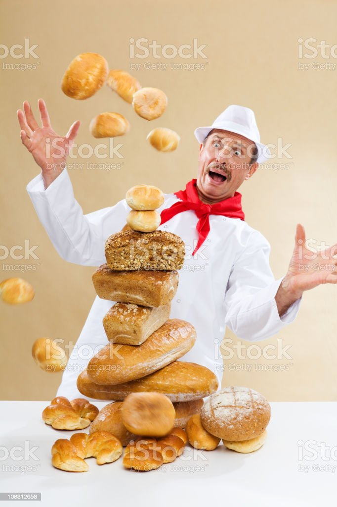 Shocked Baker With Fresh Bread royalty-free stock photo