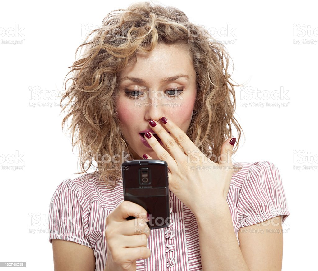 Shocked beautiful blonde woman reading text message stock photo