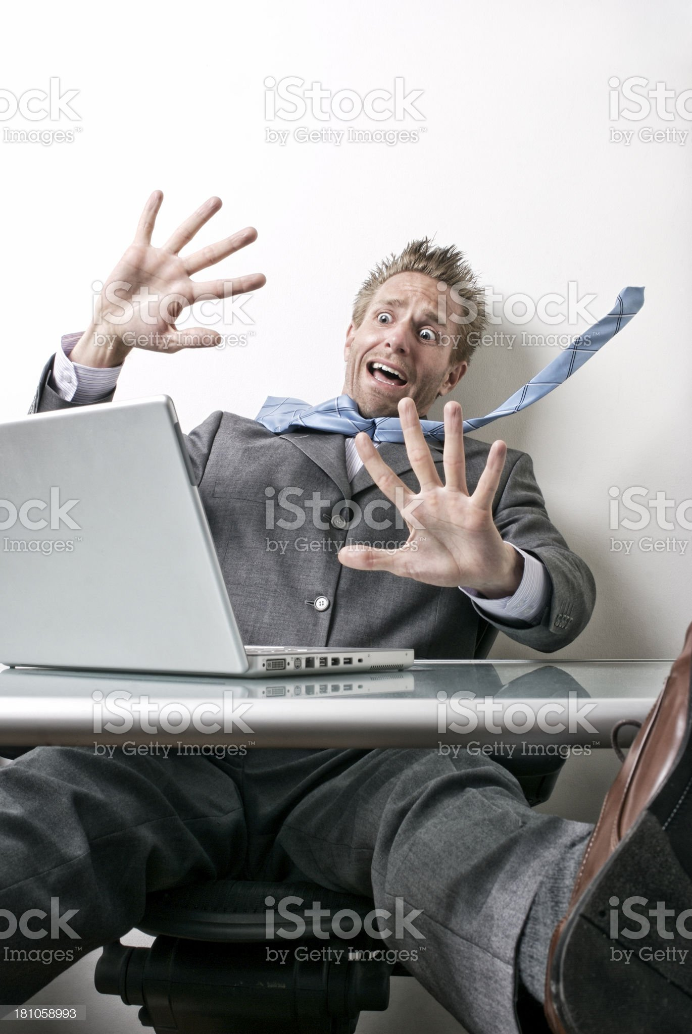 Shocked Businessman Looks Surprised at Laptop on Desk royalty-free stock photo