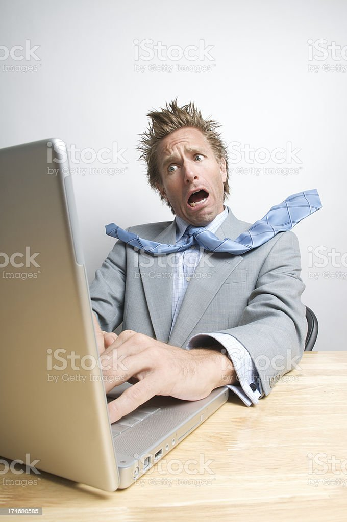 Shocked Businessman Office Worker Stressed Working at Laptop Computer royalty-free stock photo
