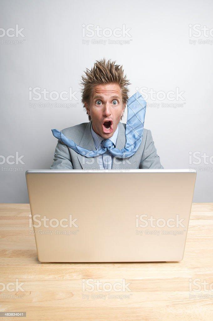 Shocked Businessman on Internet Using Laptop at Desk royalty-free stock photo