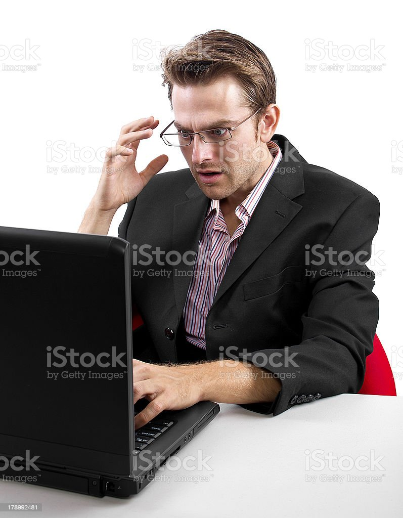 Shocked Businessman Receiving Bad News on His Computer royalty-free stock photo