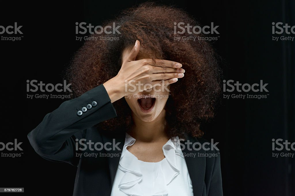 Shocked businesswoman covering her eyes stock photo