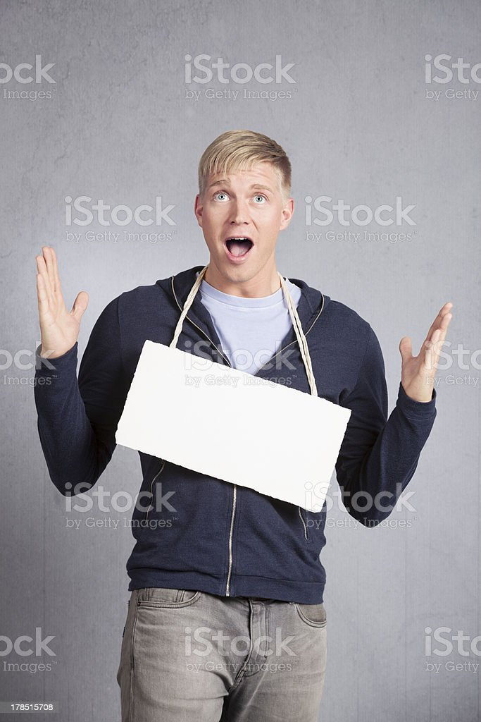 Shocked concerned man showing empty signboard. royalty-free stock photo