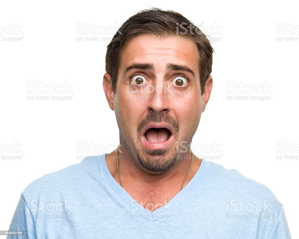 Shocked gasping young man wearing blue shirt stock photo