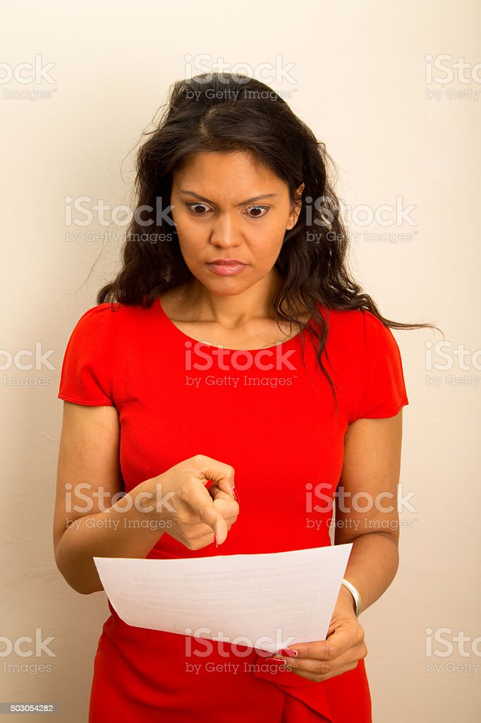 shocked girl reading a letter stock photo