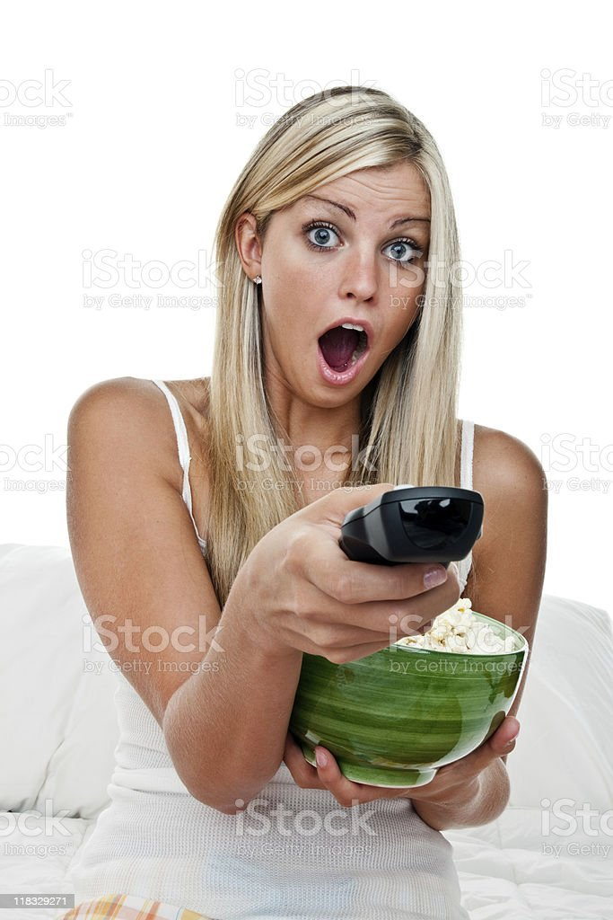 Shocked girl watching a movie royalty-free stock photo