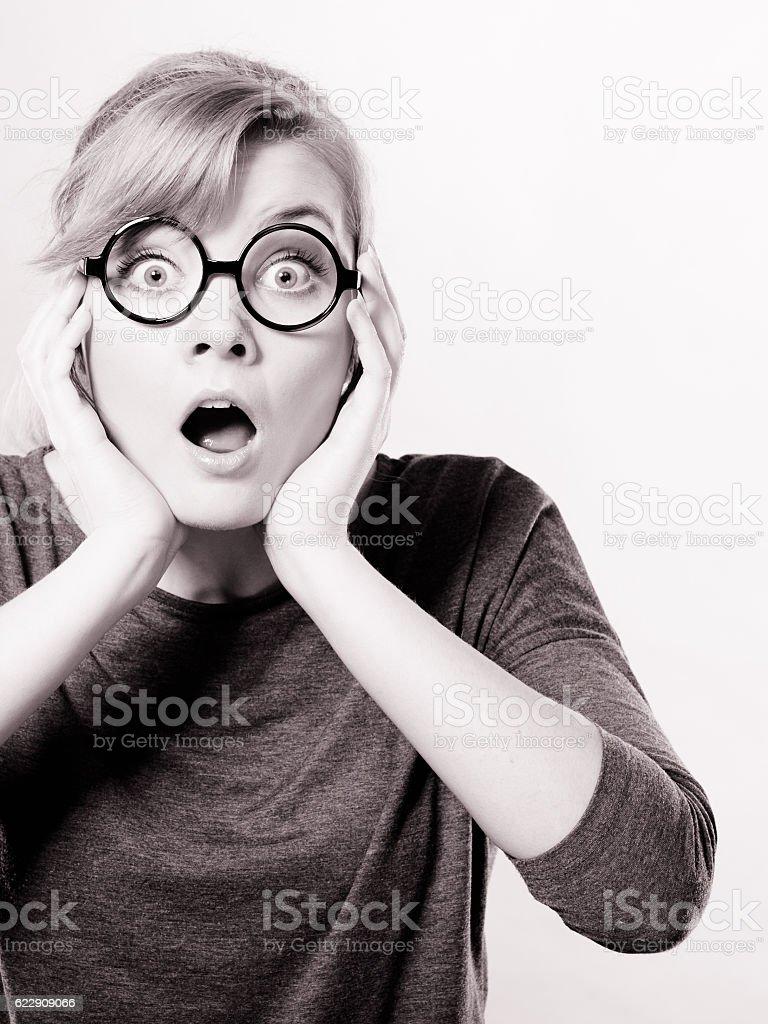 Shocked lady expressing awe. stock photo