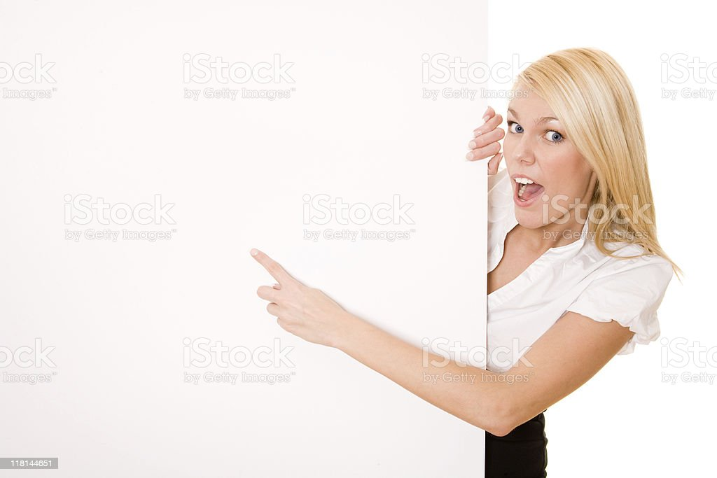 Shocked looking businesswoman pointing at the placard royalty-free stock photo
