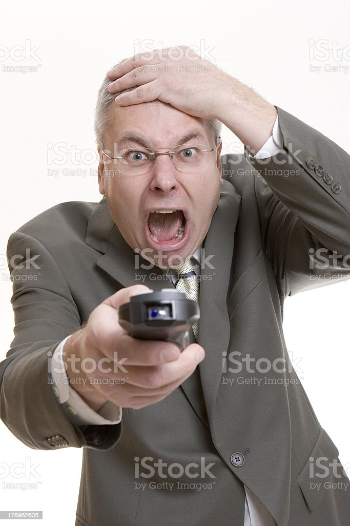 Shocked man holding remote control royalty-free stock photo