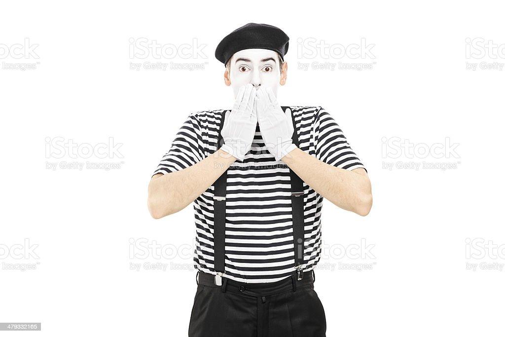 Shocked mime artist standing in disbelief stock photo