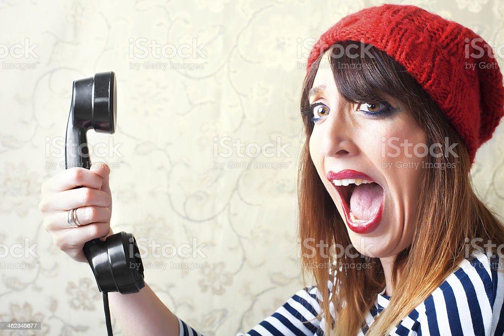 shocked Pin-Up girls screaming on vintage phone royalty-free stock photo