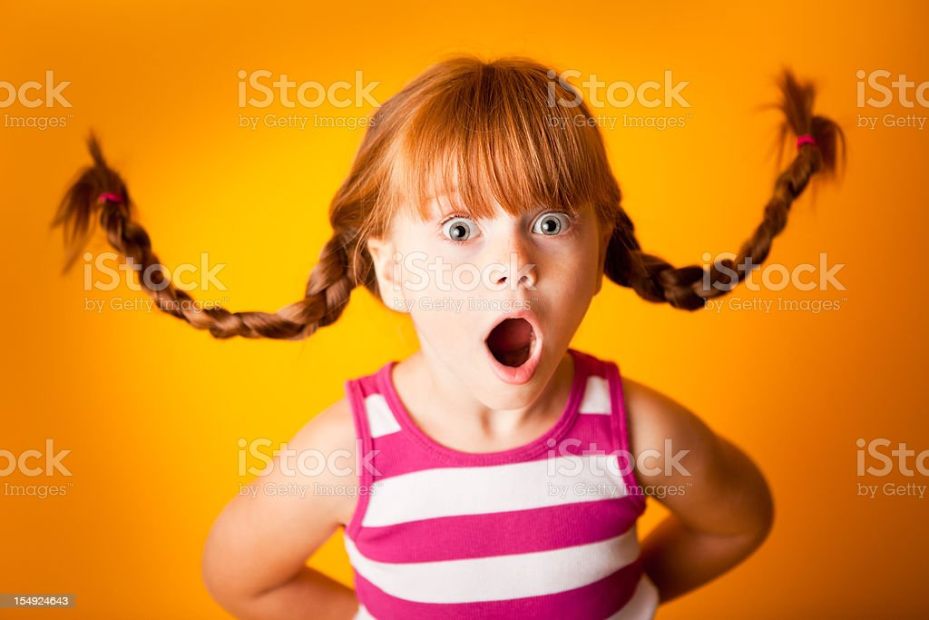 Shocked, Red-Haired Girl with Look of Surprise royalty-free stock photo