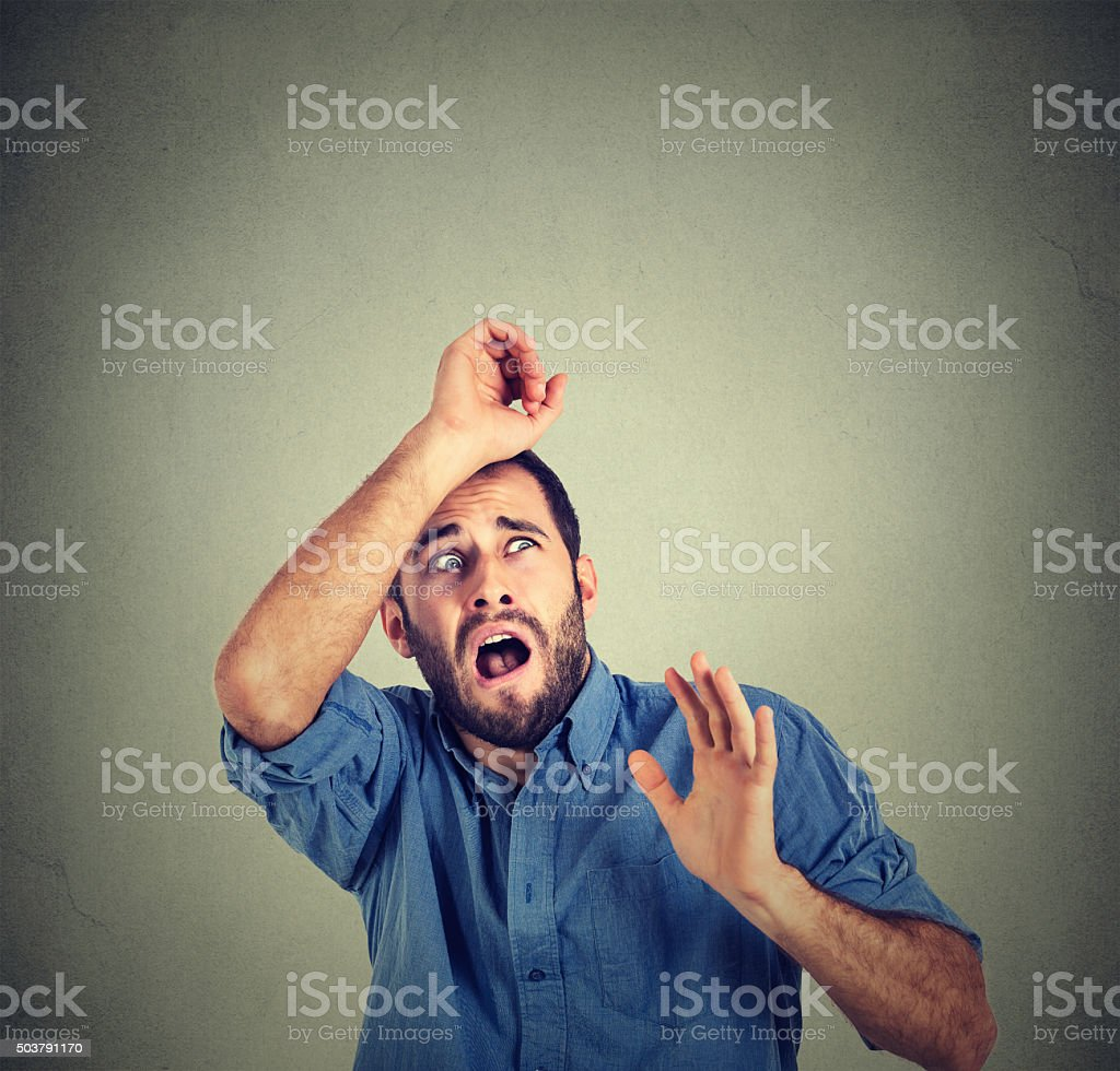 shocked scared man trying to protect himself from unpleasant situation stock photo