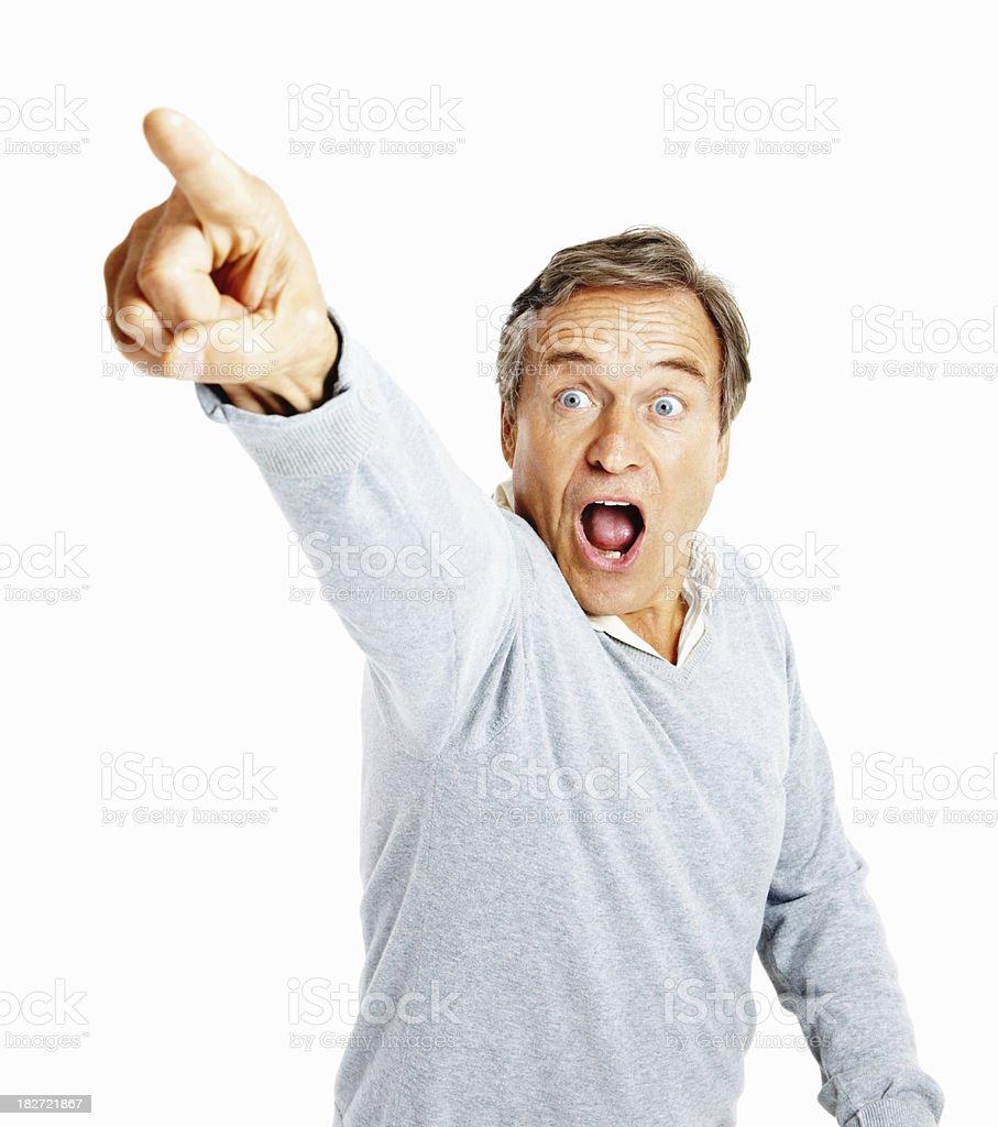 Shocked senior man pointing away against white royalty-free stock photo