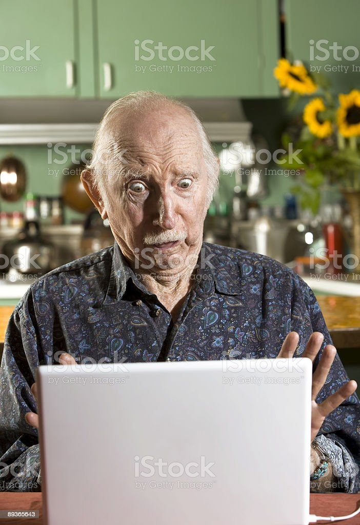 Shocked Senior Man with a Laptop Computer royalty-free stock photo