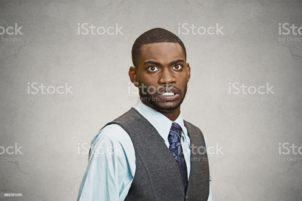 shocked, stunned, surprised young business man fear in eyes, wide open stock photo