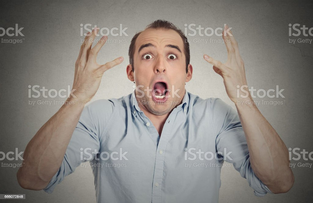 shocked stunned surprised young man eyes mouth wide open stock photo