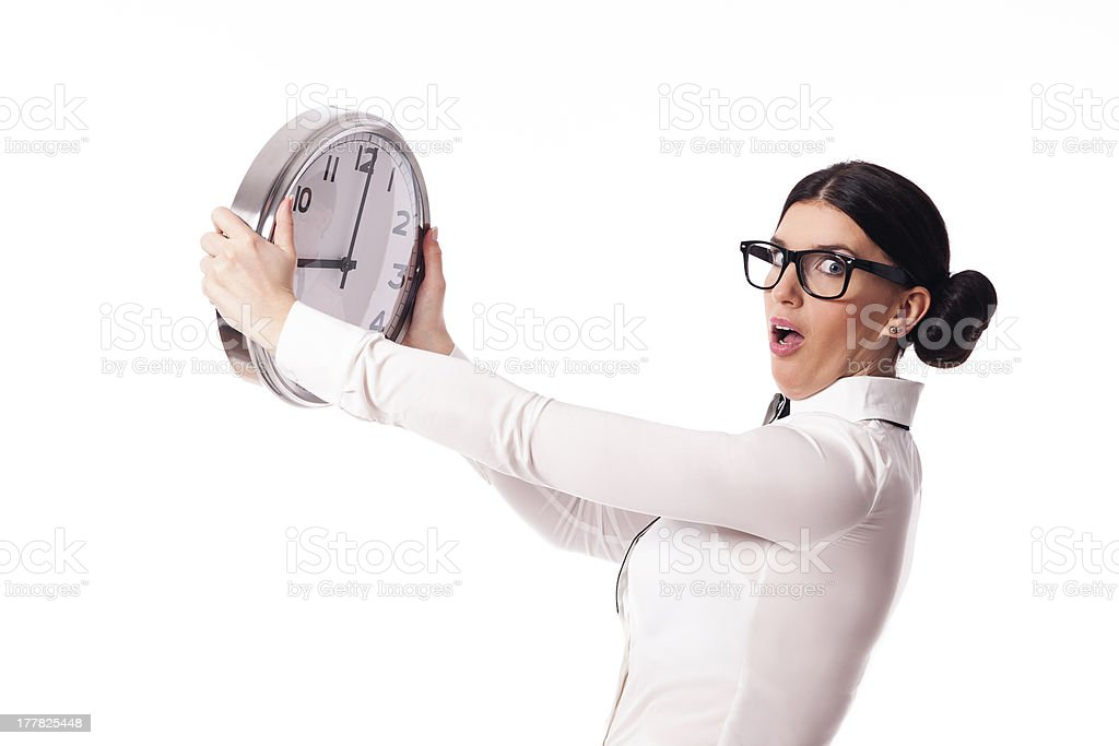 Shocked woman holding a office clock royalty-free stock photo