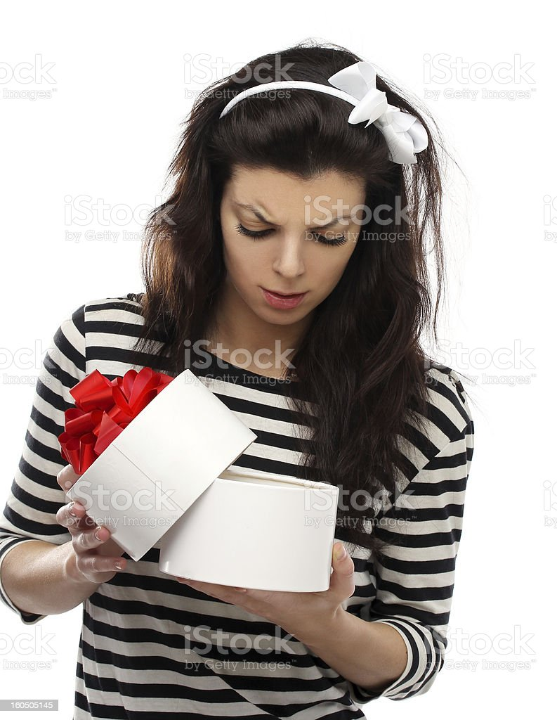 Shocked Woman holding Gift Box royalty-free stock photo