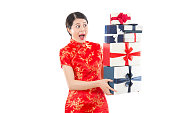 shocked woman holding many gift boxes