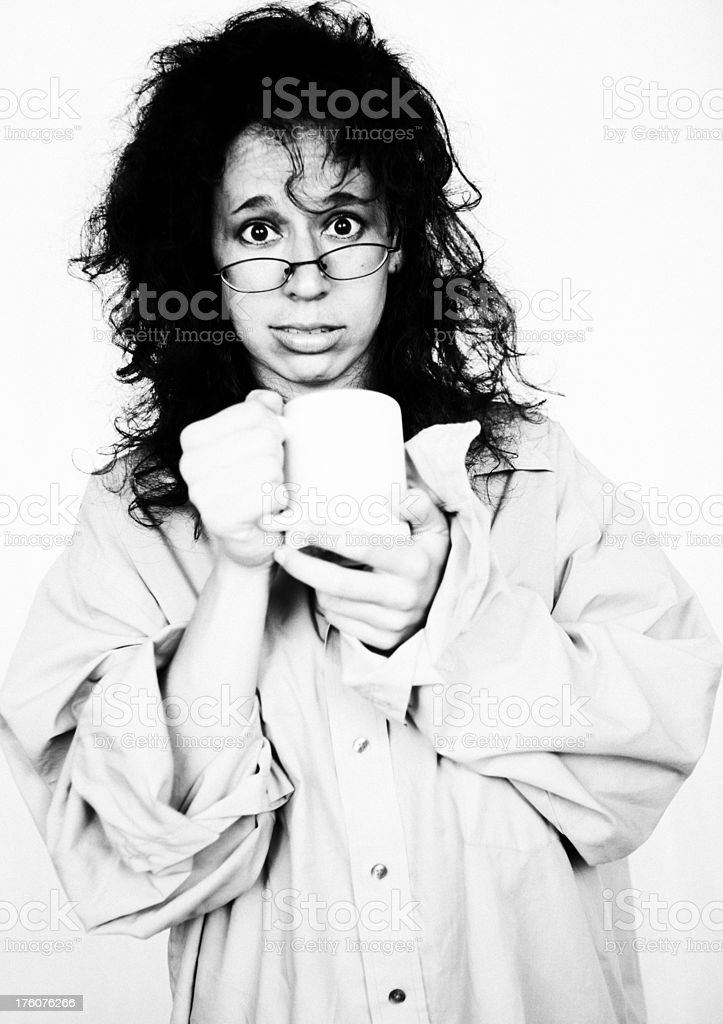 Shocked  woman in mans shirt  holding a coffee cup stock photo