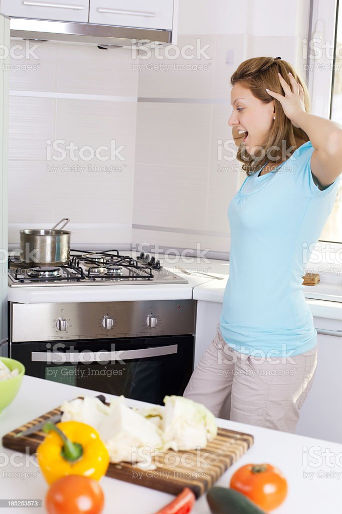 Shocked woman looking at the pan. stock photo