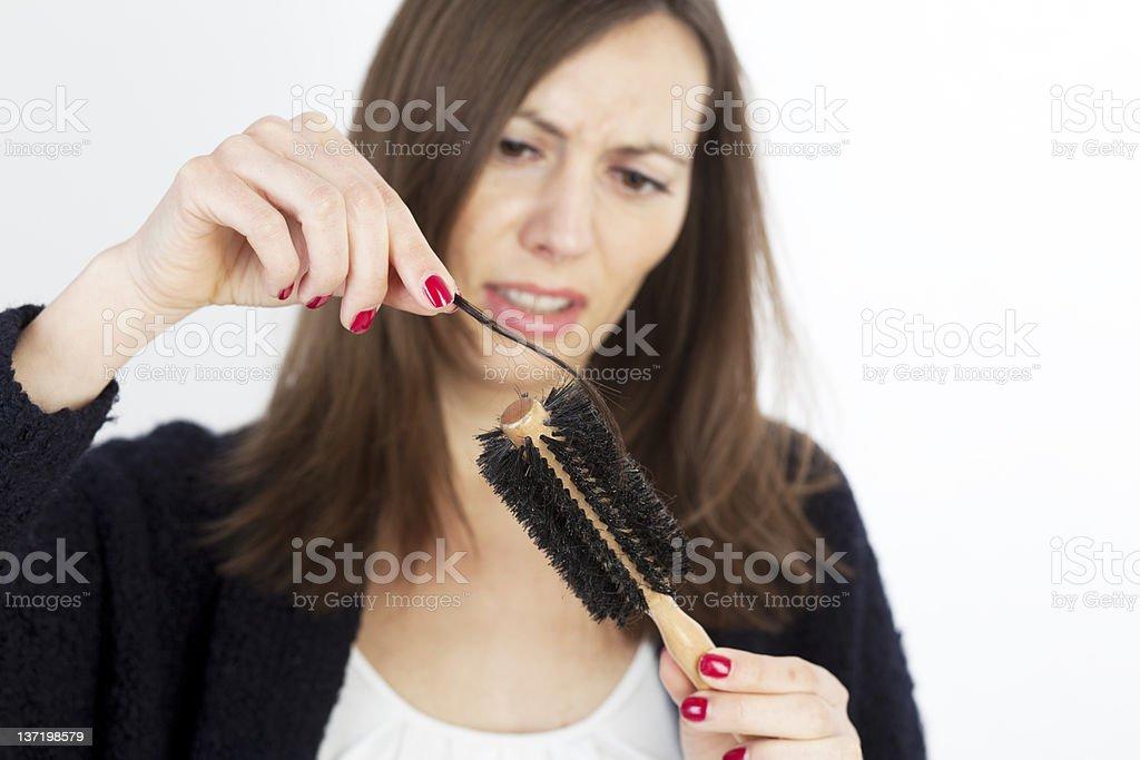 shocked woman losing hair on hairbrush royalty-free stock photo