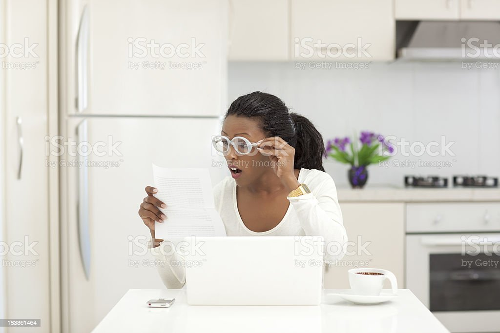 Shocked woman reading surprise letter. royalty-free stock photo