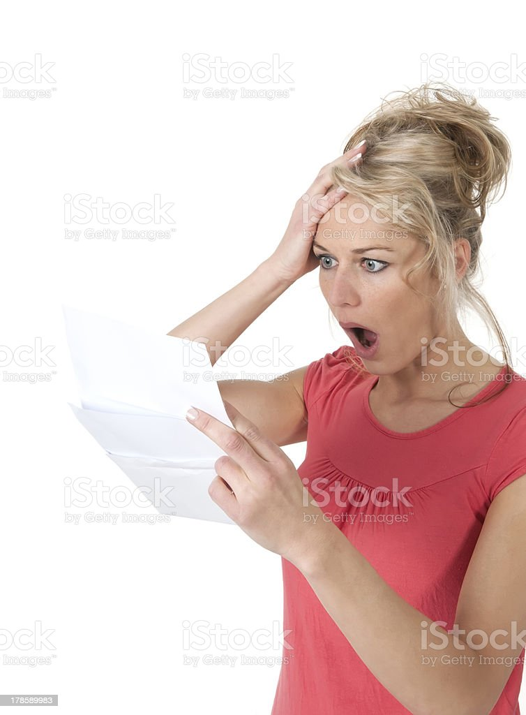 shocked woman with bad news stock photo
