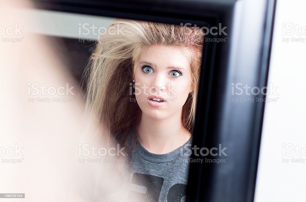 Shocked Young Adult With Messed Up Hair stock photo