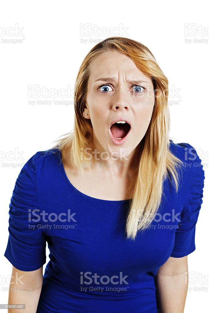 Shocked young blonde woman reacting to something in horror royalty-free stock photo