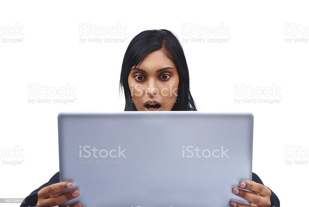 Shocked young businesswoman looking at laptop royalty-free stock photo