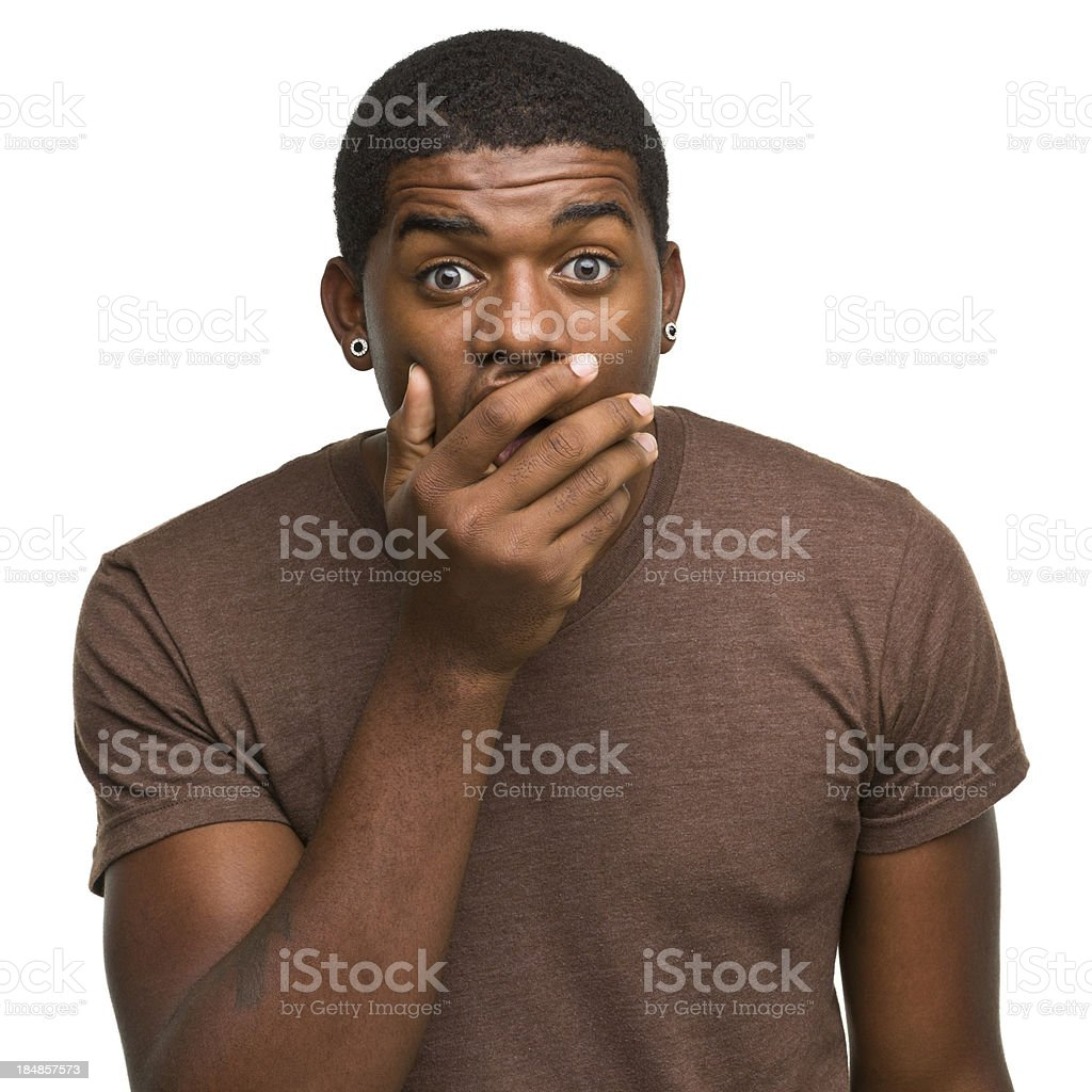 Shocked Young Man Covers Mouth stock photo