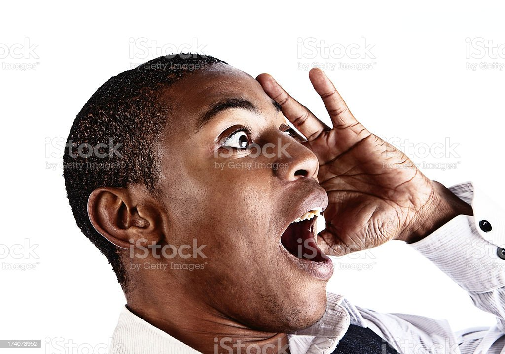 Shocked young man gasps, hand to his head, looking sideways stock photo