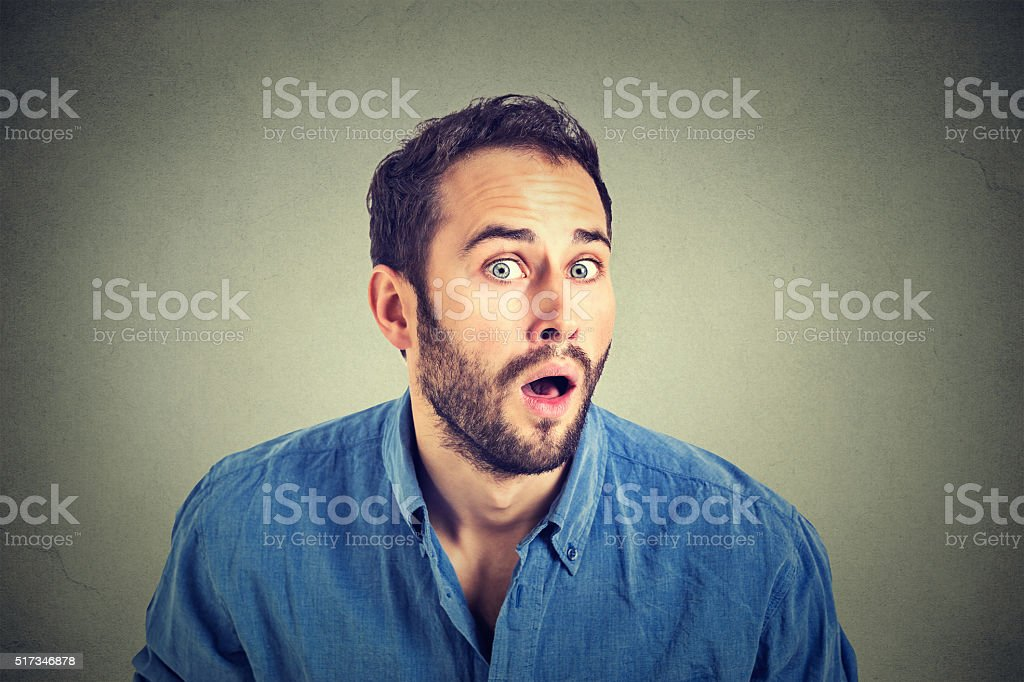 shocked young man in full disbelief stock photo