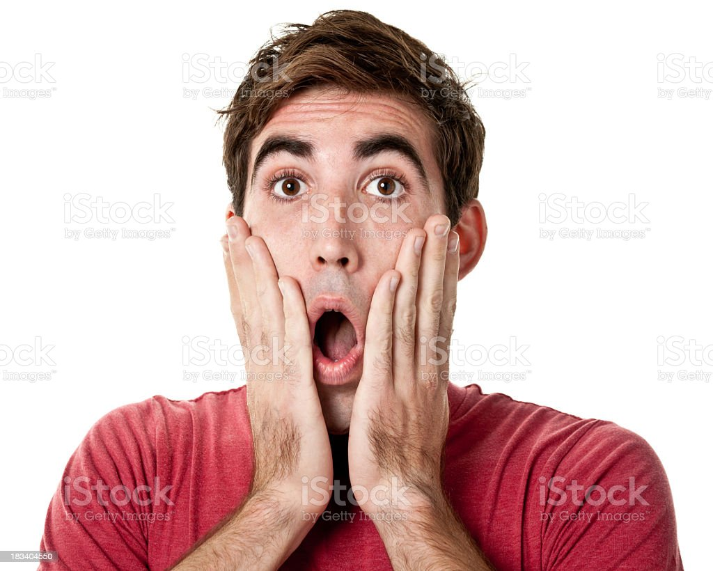 Shocked Young Man With Hands On Cheeks stock photo