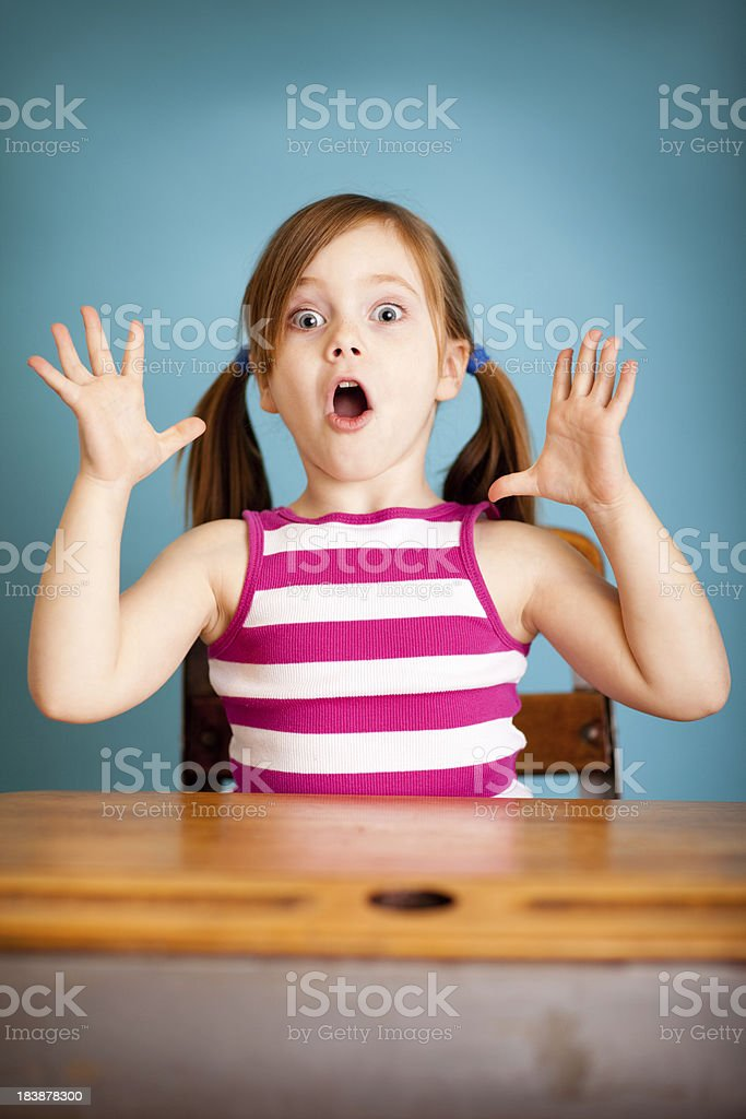 Shocked Young Student Girl in School Desk royalty-free stock photo