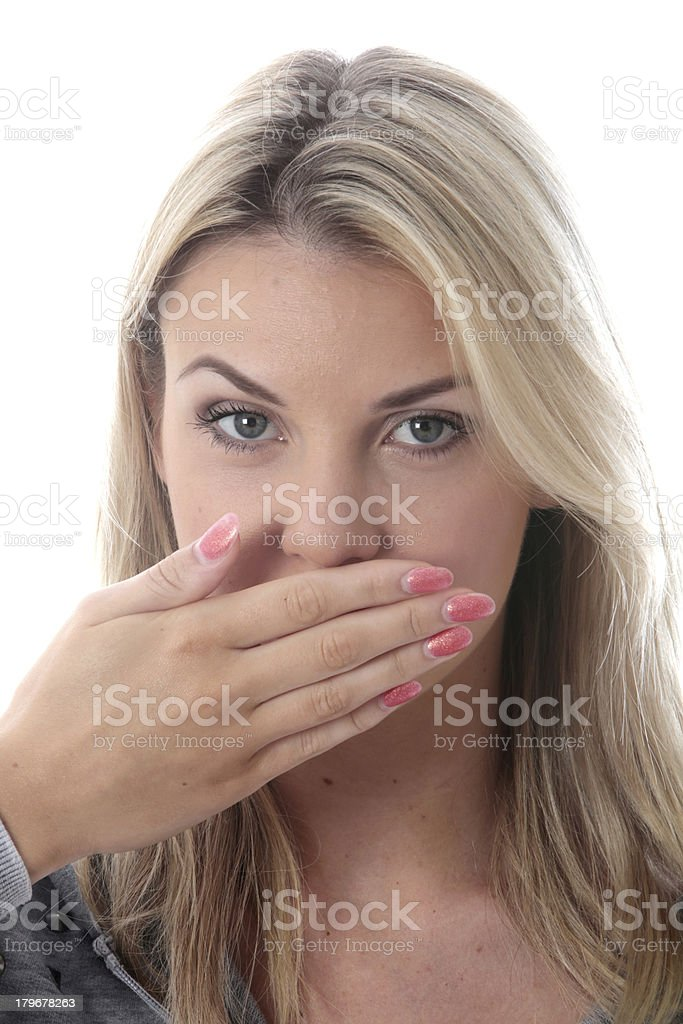 Shocked Young Woman Covering Her Mouth stock photo