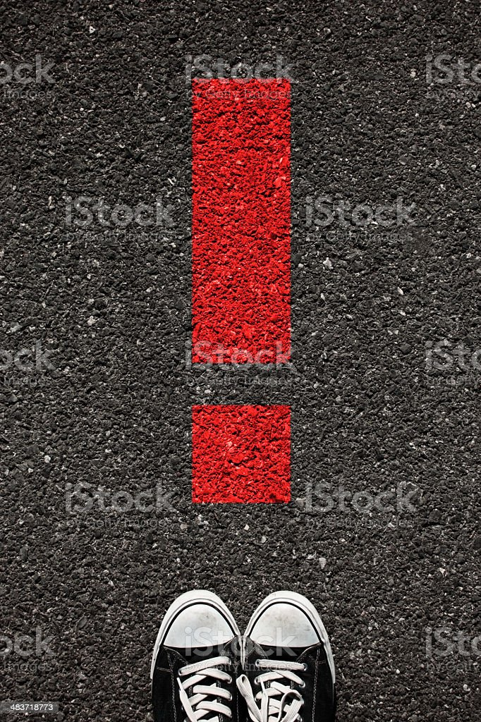 Shoe and exclamation stock photo