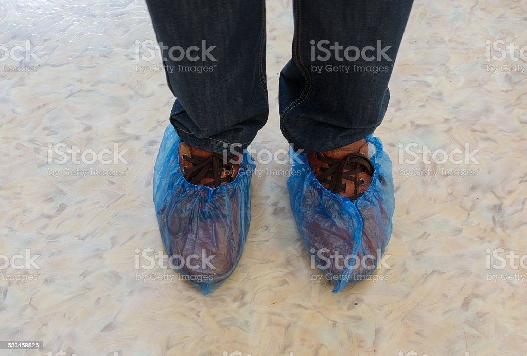 Shoe Covers on Feet stock photo
