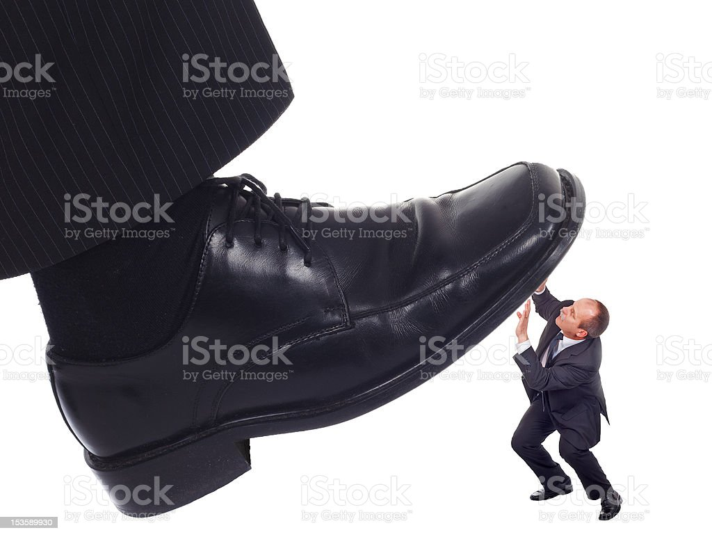 Shoe crushing a businessman royalty-free stock photo