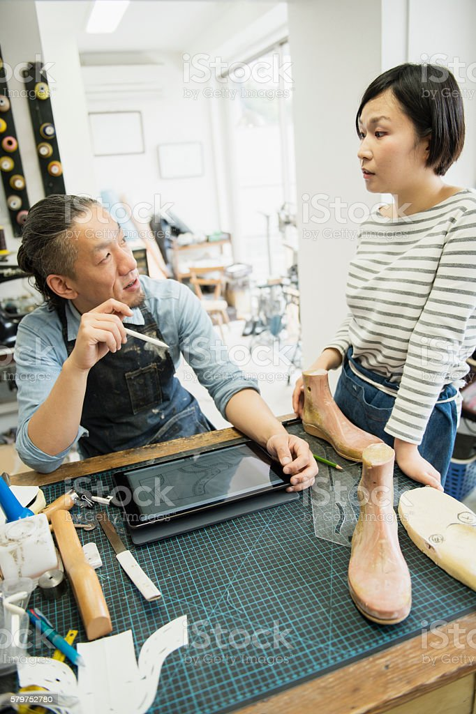 Shoe deisgners working at the factory stock photo