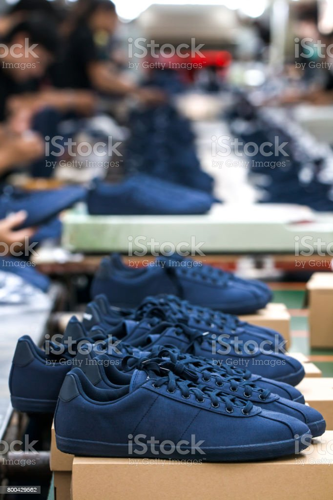 shoe making process in factory stock photo